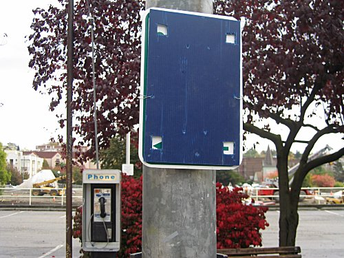 [Blue panel covering street sign]