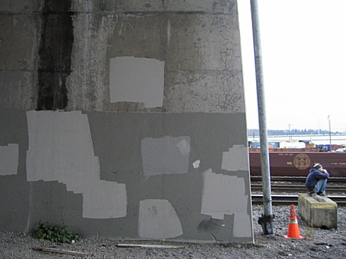 [painted-over graffiti]
