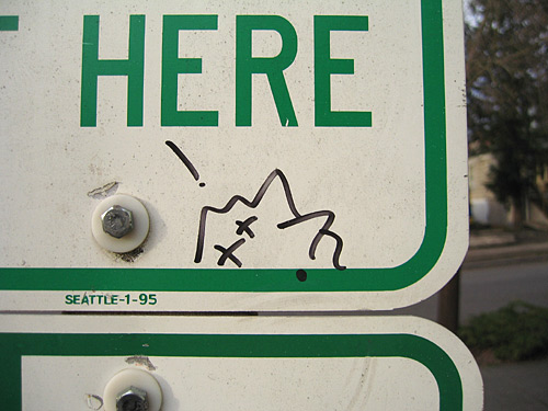 "[Street sign closeup: ""Here""]"