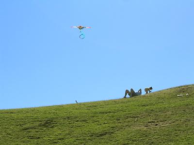 [Green hill, kite]