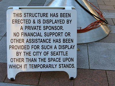 "[Sign: ""No financial support or other assistance has been provided . . . by the city of Seattle""]"