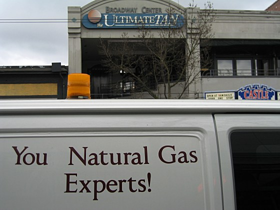 """[Sign on the side of a van: """"YouNatural Gas Experts""""]"""
