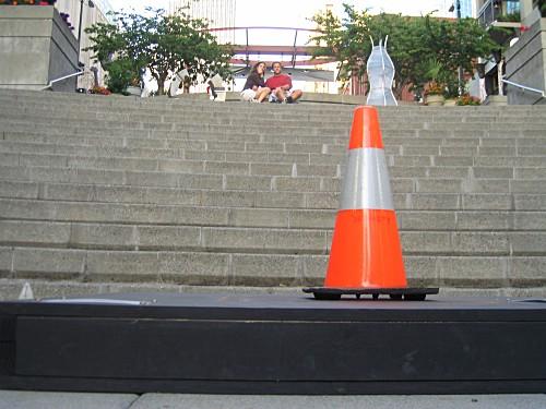 [orange traffic cone]