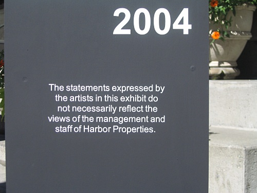 "[sign:""The statements expressed by the artists in this exhibit do not necessarily reflect the views of the management and staff of Harbor Properties""]"