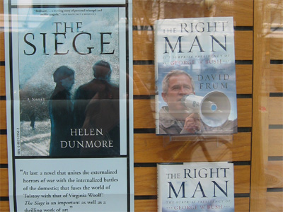 Bush book display next to poster for The Siege
